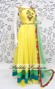 Exclusive Full Flair Light Yellow Satin Silk Outfit with Elegant Handwork On top. Bottom of this Outfit Split With Full Flair Palazzo pant. Indian Fashion Dresses, Indian Gowns Dresses, Dress Indian Style, Indian Designer Outfits, Designer Dresses, Indian Skirt, Indian Wedding Outfits, Indian Outfits, Palazzo