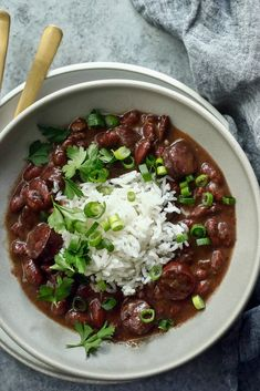 NYT Cooking: Every Monday, you can find a pot of red beans and rice cooking in someone's kitchen in New Orleans. The food writer and New Orleans bon vivant Pableaux Johnson's house is no exception. The dish, an easy meal from when people used to reserve Monday to do the wash, was once made with the pork bone left over from Sunday supper. In this version, Mr. Johnson strongly encourages the use of hand-made ...