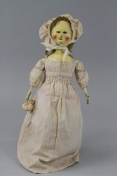 "ENGLISH WOODEN DOLL - Late ""Queen Anne"" or early ""Georgian"" period, carved wooden doll dressed in an antique fabric in style of period."
