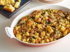 Find showstopping Thanksgiving stuffing and dressing recipes from Food Network, including cornbread, sausage and herb, oyster variations and more. Herb Stuffing, Oyster Stuffing, Turkey Stuffing, Cornbread Stuffing, Seafood Stuffing, Oyster Stew, Stuffing Recipes For Thanksgiving, Holiday Recipes, Holiday Foods