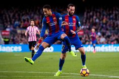 Neymar Santos Jr (L) of FC Barcelona jumps as Aleix Vidal conducts the ball to score his team's tirhd goal during the La Liga match between FC Barcelona and Athletic Club at Camp Nou  stadium on February 4, 2017 in Barcelona, Catalonia.