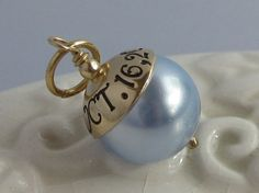 Something Blue--pearl charm with wedding date engraved...tie it to the bouquet and then wear it as a necklace after the wedding! Cute Idea!!
