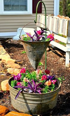 Denise does some vintage container gardening in an old galvanized tub...