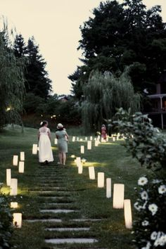 tall lanterns leading the way to the wedding