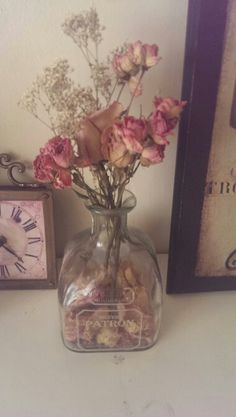Old bottle and dried flowers become shabby chic bathroom decor