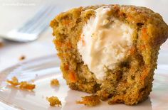 We turned our carrot cake muffins inside out! The frosting in these carrot cake muffins is baked inside, making for a delicious surprise with every bite!