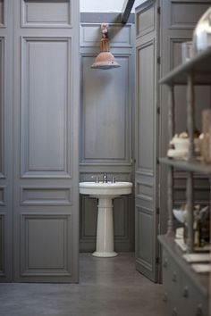 Belgian wall panels and a French streetlight make this small water closet a well-designed haven.  Source:Design*Sponge - Rob Brinson & Jill Sharp Brinson