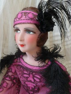Another nice doll by this lady. Her dolls are always pretty but they are re-dressed.  I hope the buyers know that.