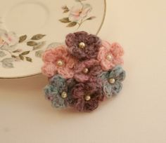Crochet flowers - this looks like a small bouquet.  It looks dainty and they won't die.