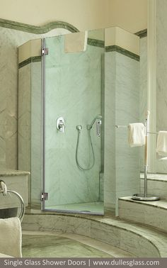 This single glass shower door makes a dramatic statment with gray single frameless shower doors from dulles glass high quality shower doors for the washington dc metropolitan area planetlyrics Image collections