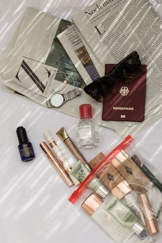 beauty travel essentials with ysl glow shot caudalie eye cream and bioderma
