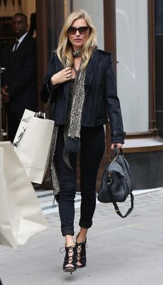 Kate Moss - Sept 11, 2014 - London is calling as the New York shows end, and Kate Moss—spotted earlier today outside of Burberry's shop—is clearly getting into the spirit. Although her one-tone look may initially seem severe, Moss's jacket adds texture and contrast, while her animal-print scarf steals the show. A streamlined duffle from Louis Vuitton and corset-strap-style heels keep things refined, while tortoiseshell sunglasses keep this shady lady looking effortlessly cool.