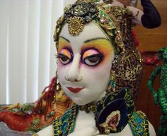 close-up shot of Arley Berryhill's Harem doll. Aren't her eyes amazing?! This exotic beauty has painted buttons for eyes with fabric eyelid and false eyelashes. It definitely defines her face and gives the entire doll attitude. (She's also sporting real earrings