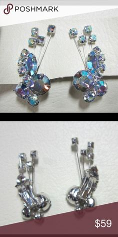 """Signed High end designer Sherman signed rhinestone Stunning signed high end designer Sherman AB rhinestone For your consideration is a  vintage pair of rhinestone earrings that are signed, """"Sherman"""". They have a ear climber design with round and navette shaped rhinestones in what looks like light blue with the ab finish. I am not sure about the base color other than it is not clear. All of the rhinestones are prong set and appear to be in good shape. One of the stems shows wear to the…"""
