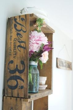 Old fruit crates with flowers in mason jar