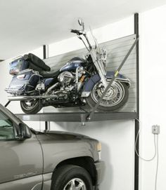 Garage Storage Solutions - Mower / Bike Lift, Popular Mechanics Keeping the garage organized can seem like an impossible task. But take heart, the storage solutions shown here will help you tackle the clutter, get organized and park inside again. Garage Shed, Garage Tools, Man Cave Garage, Garage House, Garage Workshop, Dream Garage, Small Garage, Garage Lift, Workshop Storage