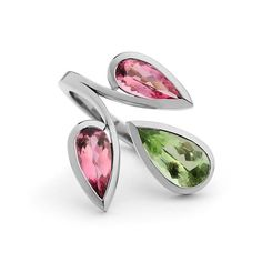 These bud like gemstones are pink tourmaline and peridot, set into 18ct white gold this ring sits elegantly on the finger.⠀ #statement #ring