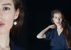 Big scratch porcelain earrings by Anna Kiryakova.