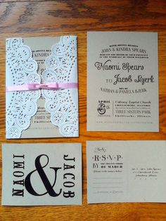 DIY Lace Wedding Invitations, think of a black and white filigree invitation wrapped in a piece of black lace with a dark blue or black ribbon tying it shut...
