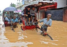 Rickshaw pullers make their way through a flooded street near Gauhati, India, on Saturday, June Several people were killed due to electrocution and landslides triggered by incessant rains in India's northeastern state of Assam, according to local reports. Arunachal Pradesh, Nature Water, Image Of The Day, News India, Incredible India, Around The Worlds, The Incredibles, Street, Yahoo News