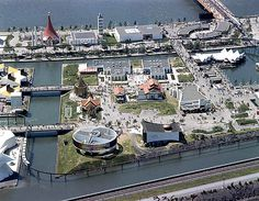 Expo 67 ~This view shows a mix of industrial and foreign pavilions located mid-island. Expo 67 Montreal, Montreal Ville, Niagara Falls Pictures, Canada 150, Lounge, Pedestrian Bridge, World's Fair, Photos Du, Aerial View