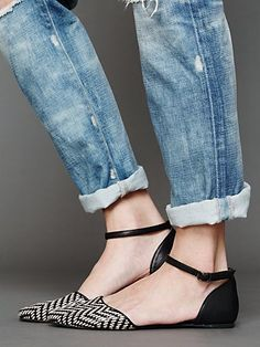 Two-tone woven leather flats with adjustable leather ankle strap and pointy toe. Rubber sole.     *By Jeffrey Campbell