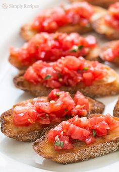 Bruschetta with Tomato and Basil ~ Chopped fresh tomatoes with garlic, basil, olive oil, and vinegar, served on toasted slices of French or Italian bread. #FourthOfJuly ~ SimplyRecipes.com