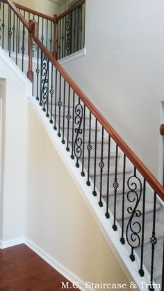 Iron baluster upgrade from M.C. Staircase & Trim. Removal of wooden balusters and installation of alternating Twist Series Single Twist and Single Basket with accenting Feathered Scrolls in Satin Black.