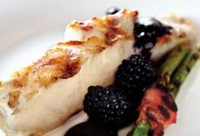 Grilled sea bass with blackberry balsamic reduction.