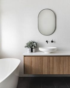 These Penny Tile Bathroom Backsplash Ideas Pack a Big Punch We're sharing our favorite penny tile bathroom backsplash ideas, from colorful to muted. Fair warning: One look and you might be tempted to makeover your own bathroom. Washroom Design, Modern Bathroom Design, Bathroom Interior Design, Toilet Tiles Design, Bath Design, Kitchen Design, Bathroom Inspo, Bathroom Inspiration, Bathroom Ideas