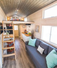 The galley kitchen is equipped with a four burner cooktop, apartment size refrigerator, and large stainless steel sink. The living room is large enough to accommodate an 11-foot sectional and has a place to mount an LCD TV.