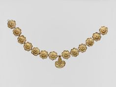13 rosettes and one pendant in the form of a lily Similar rosettes have been found at Dendra, Asine, the Argive Heraion, Mycenae, Menidi, and in Crete at Phaistos. Late Helladic III Date: ca. 1400–1050 B.C.