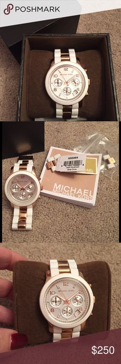 Michael Kors Rose Gold/White Chronograph Watch. This MK5464 watch features 39mm wide & 14mm thick rose gold plated stainless steel case with white silicone rubber covered bezel, date display, chronograph functionality & scratch resistant mineral crystal. Owned for a year but not worn daily. Some light surface scratches on band but not very noticeable. Back of face has scratches from battery replacement. Can't see them when the watch is on. Comes with extra links, owners manual & Michael Kors…