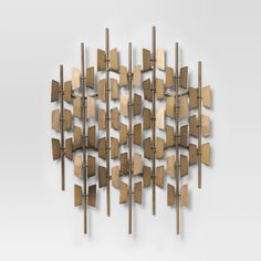 Decorating your space is easy with the Decorative Wall Sculpture from Project 62™. With a burnished gold finish, this wall sculpture brings mid-century modern style to any space. Display in any room where you need a little extra shine.<br><br>1962 was a big year. Modernist design hit its peak and moved into homes across the country. And in Minnesota, Target was born — with the revolutionary idea to celebrate design for all. Project 62 embodies this legacy with a...