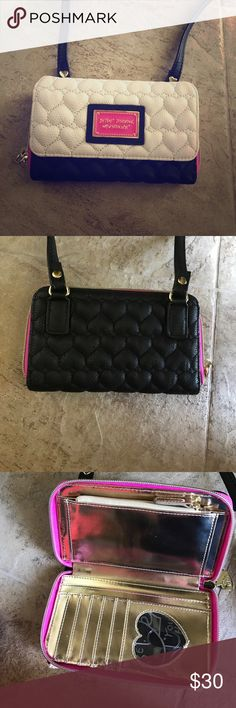 Betsey Johnson wallet Black, White, pink, and gold betsey Johnson wallet. Barely ever used, and absolute perfect condition. Long strap attached to it. Inside is All gold. Make me an offer! If you have any questions feel free to ask in the comments.😊 Betsey Johnson Bags Wallets