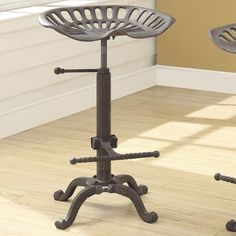 I'm in love. Holy cow. Carolina Cottage Carolina Cottage Colton Adjustable Bar Stool