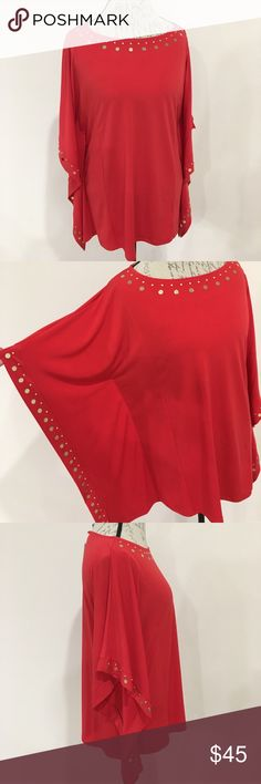 Michael Kors Tunic Brand New Spicy Red Michael Kors Tunic with wide sleeves and gold details around the sleeves and the front. Create a classy look with skinny jeans and a pair of heels! KORS Michael Kors Tops Tunics