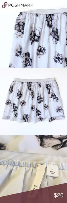 """Frenchi Sheer Short Skirt, Soft Rose Floral Print Elastic Waistband, 1"""" wide, 15.5"""" across measured flat. Length: 15.5"""". Sheer, with lining. Color: pale grey, charcoal grey and pinky tan. Tagged  Large. 100% Polyester. Full cut. This item is used and in very good condition.❤️ Frenchi Skirts"""