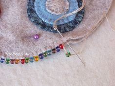 ThreeSheepStudio: How To Do A Beaded Blanket Stitch. Catch bead after comple. - ThreeSheepStudio: How To Do A Beaded Blanket Stitch…. Catch bead after completing each blanket s - Wool Embroidery, Cross Stitch Embroidery, Embroidery Designs, Blanket Stitch, Blanket Crochet, Penny Rugs, Felt Applique, Wool Felt, Sewing Crafts