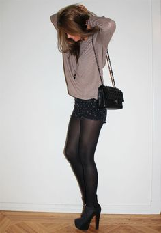 Relaxed, chic and subtly edgy. Can't get enough of loose, oversized pullovers and shorts with tights.