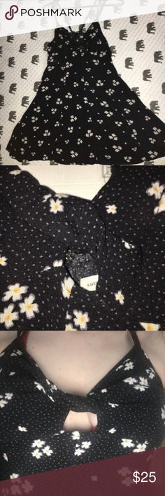 Floral dress I've only worn this dress a few time, it just isn't my style anymore. It's dark blue, floral and polka dot pattern, cut out in the front, fitting on the top and loose around the bottom, mid-thigh length. American Eagle Outfitters Dresses Mini