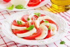 Caprese salad with tomatoes, mozzarella and basil.
