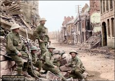 A machine gun position established by the 54th Battalion during the morning of the attack through Peronne. The photograph was taken the following day, after the capture of the town, when positions close to it had been taken. Pictured, left to right: Private Cullen, A Company, 53rd Battalion; Private A. Storen, A Company, 54th Battalion; unidentified (standing at back); Sergeant Kelly, 54th Battalion and Private McSweeney, 54th Battalion. 2 September 1918.