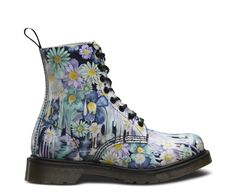 Inspired by the 'gore writing' of psychobilly flyers and artwork this splash of melting, colourful florals, drips down from the top line to the sole, updating one of Dr. Martens most iconic 8-eye boots. Our Reinvented range takes classic Dr. Martens styles and customises them, playing with their history to create something new every season.