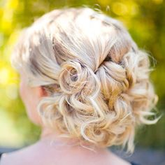 This was a beachy soft bridal updo for my model Amber. Shes got Fine medium length hair, so i curled it to get a beachy wave, then pinned it up to create the look of thicker hair. I used a large wand to Curl, some sea salt spray to rouch her hair up, then