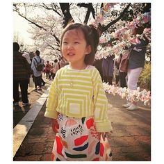 Spring joy - BOBO CHOSES Matisse print skirt and pink blossoms in abundance   Thank you @sua.hyhs for letting us share this picture of your pretty little girl
