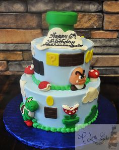 We made this really cool Super Mario Brothers themed cake for a 6th birthday party. Description from alittlecake.com. I searched for this on bing.com/images