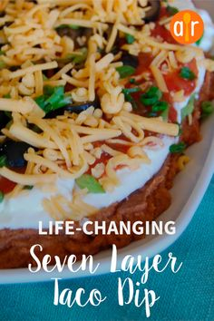 Seven layer taco dip made with refried beans, sour cream, and salsa is the perfect platter for parties and family get-togethers. Dip Recipes, Appetizer Recipes, Appetizers, Seven Layer Taco Dip, Layered Taco Dip, Green Salsa, Tailgating Recipes, Football Food, Game Day Food