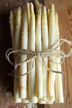 White asparagus. Growers make asparagus white by shielding it from the sun, thus stifling the production of chlorophyll. The result is daintier looking and a bit more tender than green asparagus.