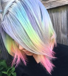 Another shot of the iced out pastel rainbow I gave my girl Christa when I visited Florida. Thanks for letting me have some fun  Thanks as well to @jason_headstrong for letting me use your space and @houseofbosley for being the best dang assistant/BFF who ever lived  All tones diluted with @Olaplex #2. #pastelhair #silverhair @hairstyles @behindthechair_com @modernsalon @meltcosmetics